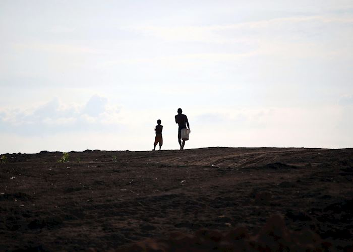Father and son heading home - Tonle Sap