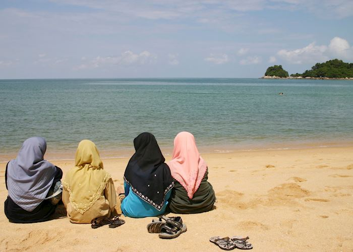 Local women relax on the beach, Langkawi