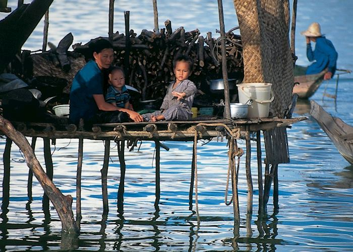 Local family resting in their house on Tonle Sap Lake, Siem Reap