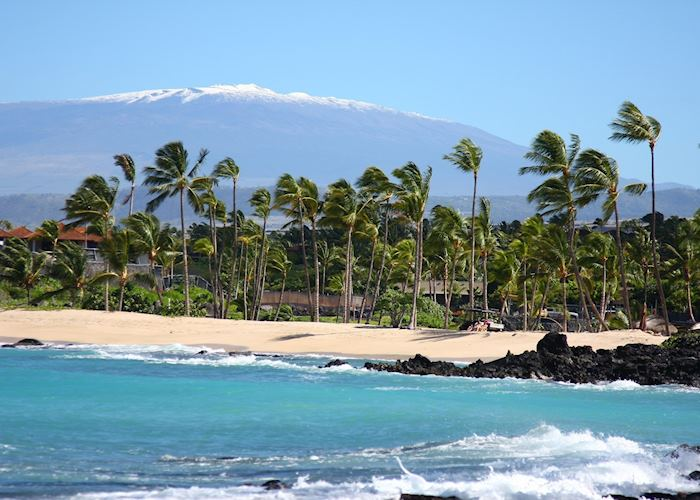 Beach with snow capped Maunakea.