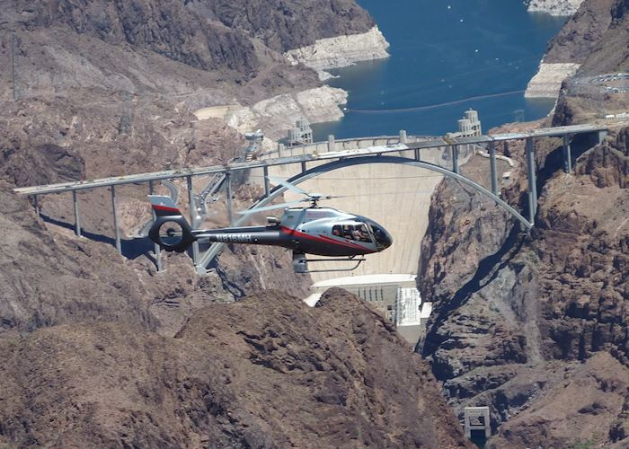 A helicopter over the Hoover Dam