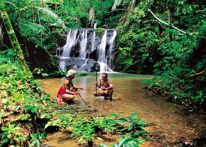 Iban hunters at waterfall, Lemanak River, Malaysian Borneo