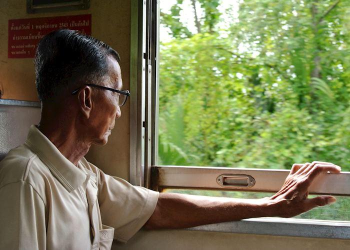 Gentlemen on a local train ride in Amphawa, Thailand