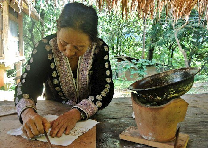 Lady showing the technique for Batik, Chiang Khong, Thailand