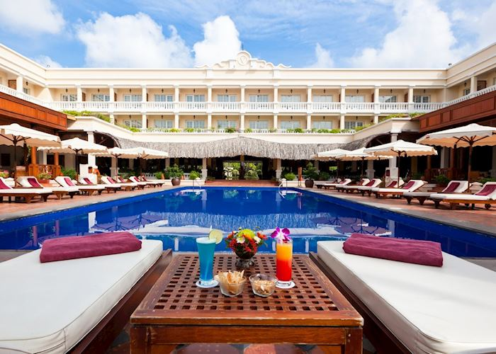 Relax by the pool at the Victoria Hotel, Can Tho