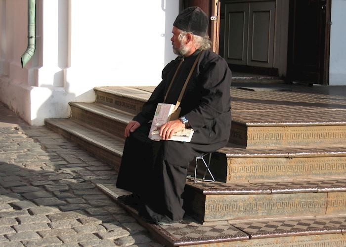 Old monk on steps, Moscow