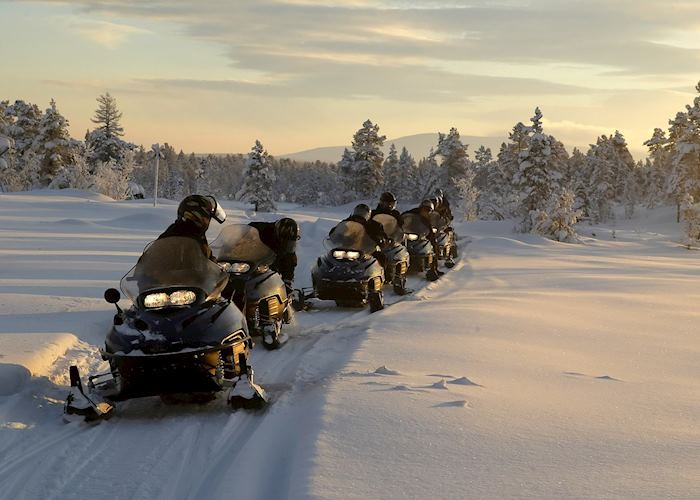 Morning snowmobile tour with hearty log cabin breakfast