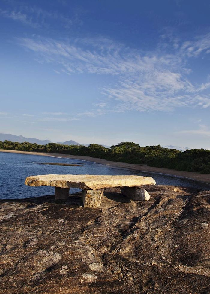 Stone bench overlooking the ocean - Manafiafy, Madagascar