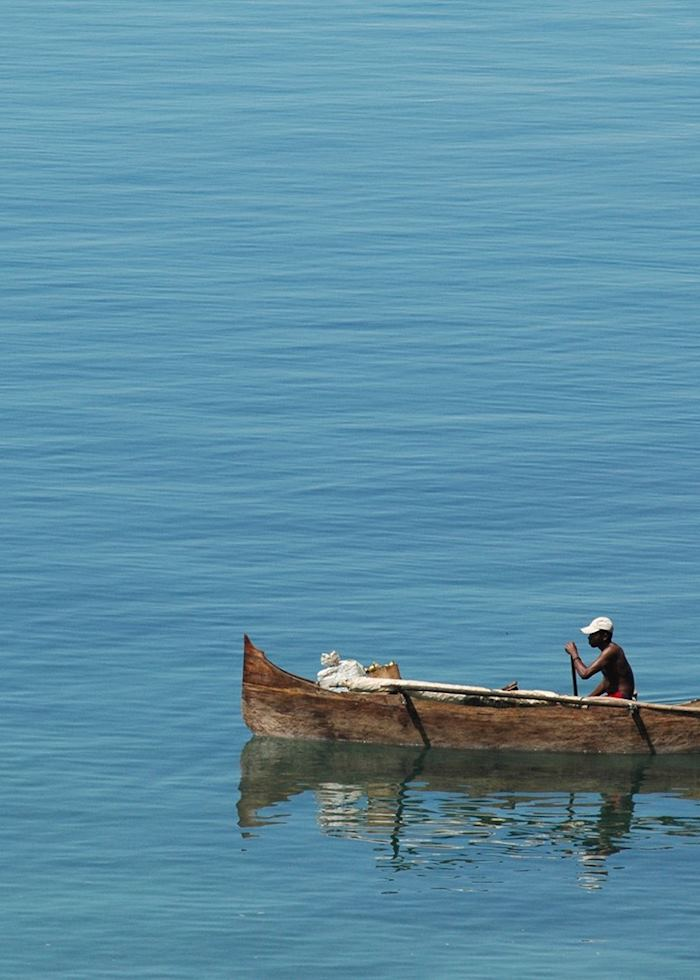 Fisherman in a pirogue off Nosy Komba